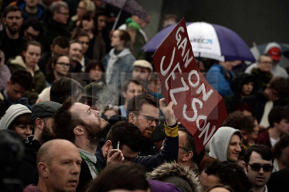 © Licensed to London News Pictures. 05/06/2017. Newcastle Upon Tyne, UK.  Locals wave home-made signs as they wait for Jeremy Corbyn MP, Leader of the Labour Party, to address them after they waited in the rain to hear him speak outside the Sage in Gateshead. Mr Corbyn spent one of the final days of the campaign trail in the Labour heartlands of North-East England before voters go to the polls in the UK General Election on June 8th 2017. Photo credit: MARY TURNER/LNP