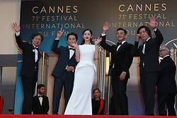 Actor Steven Yeun, actress Jong-seo Jeon, actor Ah-in Yoo and director Chang-dong Lee attend the screening of Burning during the 71st annual Cannes Film Festival at Palais des Festivals on May 16, 2018 in Cannes, France. Photo by Shootpix/ABACAPRESS.COM