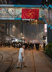 Hong Kong. 7 October 2019. Pro democracy demonstration in Hong Kong. Violent clashes between police and protestors. Property with Pr0-Beijing links vandalised.