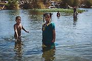 Kids playing in the Nile at Kodi, Seheil Island