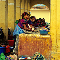 Central America, Guatemala, Antigua. The public laundromat is a gathering place for women to wash and socialize in Antigua, Guatemala.