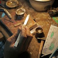 Asia, China, Hong Kong. Jeweler workspace of Aberdeen Jewellers.