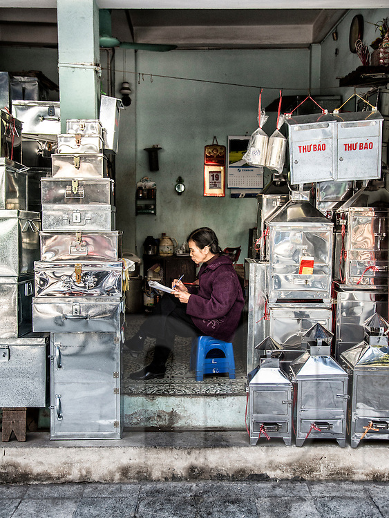 Shop of metal containers along Hang Thiep street known for metal products in Hanoi's Old Quarter, Vietnam, Southeast Asia