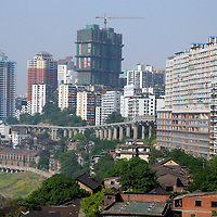 Asia, China, Chongqing. Contrast of traditional homes and modern skyscrapers of Chongqing.