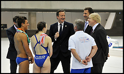 """File Photo - Olympic diver Tom Daley has revealed he is in a relationship with a man.<br /> <br /> Britain's Prime Minister David Cameron and Mayor of London Boris Johnson (R) together with Jeremy Hunt Secretary of State for Culture, Olympics, Media and Sport Talk to British Diver Tom Daley and members of the British Diving team during a visit to the Olympic Aquatic Centre on January 9, 2012 in London, England. Cameron held a cabinet meeting at the 2012 Olympic Games site and highlighted the 'lasting legacy' the London 2012 Olympics will leave, as the London Olympics countdown enters its final 200 days, Monday January 9, 2012. Photo By Andrew Parsons/ i-Images<br /> <br /> Olympic diver Tom Daley has revealed he is in a relationship with a man.<br /> <br /> In a YouTube broadcast, the 19-year-old London 2012 bronze medallist said: """"In spring this year my life changed massively when I met someone, and they make me feel so happy, so safe and everything just feels great.<br /> <br /> """"That someone is a guy.""""<br /> Photo By Andrew Parsons/ i-Images"""
