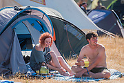 The last morning and people begin to pack but for others it is time for the usual breakfast in the campsite - The 2018 Latitude Festival, Henham Park. Suffolk 15 July 2018