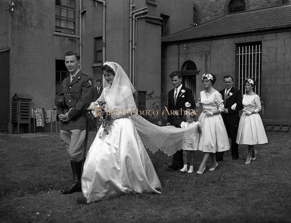 29/08/1959<br /> 08/29/1959<br /> 29 August 1959 <br /> Wedding of Lt. Anthony (Tony) Wall, 10 Fianna Road, Thurles, Co. Tipperary and Artillery Barracks, Kildare, Captain of last year's Senior All-Ireland Tipperary Hurling team, and Miss Elizabeth Barclay of New Bride Street, Dublin at the Church of St Nicholas of Myra, Francis St., Dublin. The Matron of Honour was Mrs. Kay Fitzpatrick (sister of the Bride) an the Bridesmaid was Miss Helen Wall (sister of Groom). Mr. Aidan Wall (brother of Groom) was Bestman and Mr. John Barclay (brother of the Bride) was Groomsman.