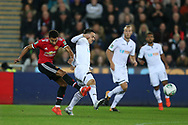 Roque Mesa of Swansea city © blocks a shot from Jesse Lingard of Manchester Utd (l).  EFL Carabao Cup 4th round match, Swansea city v Manchester Utd at the Liberty Stadium in Swansea, South Wales on Tuesday 24th October 2017.<br /> pic by  Andrew Orchard, Andrew Orchard sports photography.