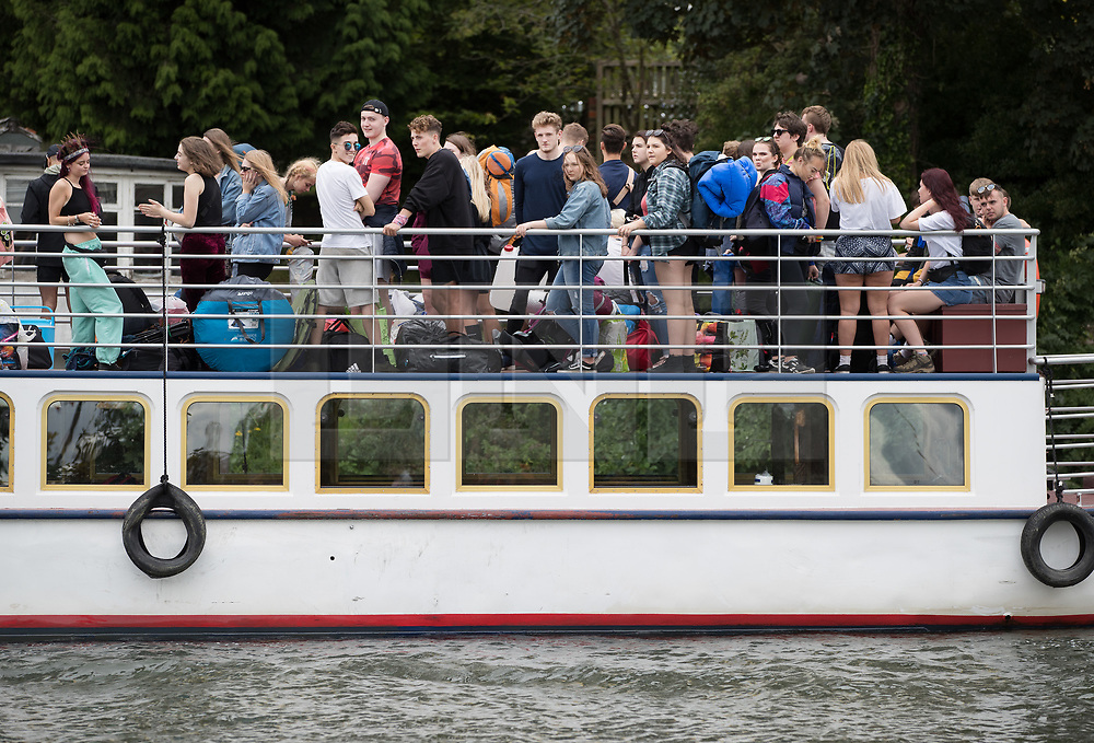 © Licensed to London News Pictures. 24/08/2017. Reading, UK. Music fans make their way to Reading Festival by boat along the river Thames. The weather is expected to stay fine for the start of the three day music festival. Photo credit: Peter Macdiarmid/LNP