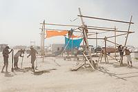 Burners building their camp structure. My Burning Man 2018 Photos:<br /> https://Duncan.co/Burning-Man-2018<br /> <br /> My Burning Man 2017 Photos:<br /> https://Duncan.co/Burning-Man-2017<br /> <br /> My Burning Man 2016 Photos:<br /> https://Duncan.co/Burning-Man-2016<br /> <br /> My Burning Man 2015 Photos:<br /> https://Duncan.co/Burning-Man-2015<br /> <br /> My Burning Man 2014 Photos:<br /> https://Duncan.co/Burning-Man-2014<br /> <br /> My Burning Man 2013 Photos:<br /> https://Duncan.co/Burning-Man-2013<br /> <br /> My Burning Man 2012 Photos:<br /> https://Duncan.co/Burning-Man-2012