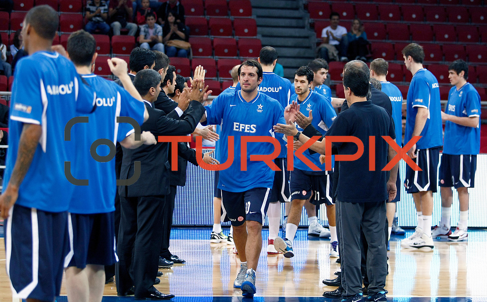 Anadolu Efes's Kerem TUNCERI (C) during their Two Nations Cup basketball match Anadolu Efes between Panathinaikos at Abdi Ipekci Arena in Istanbul Turkey on Saturday 01 October 2011. Photo by TURKPIX
