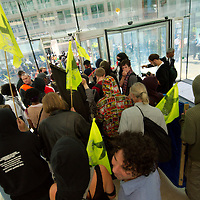 LONDON, ENGLAND - SEPTEMBER 08:  Protestors manage to break the security lines at BT building in the City of London.  A march took place targeting major Banks and corporation  on September 8, 2009 in London, England.  (Photo by Marco Secchi/Getty Images)