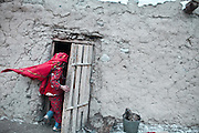 Chinor rushes inside the family home. With winter approaching, most time will be spent indoors.