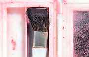 extreme closeup of empty make up box with brush and mirror