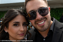 Zach Ness with his girlfriend Alessandra Filosa (of Italy) at the Arlen Ness Memorial - Celebration of Life at the Arlen Ness Motorcycles store. Dublin, CA, USA. Saturday, April 27, 2019. Photography ©2019 Michael Lichter.
