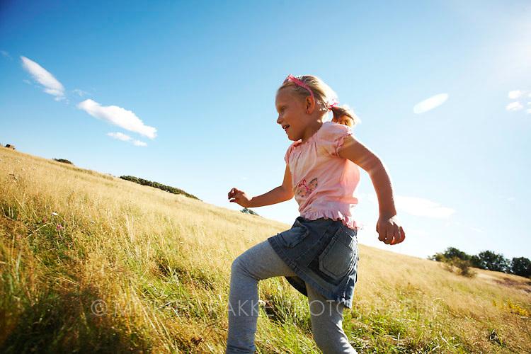 Girl running in grassland