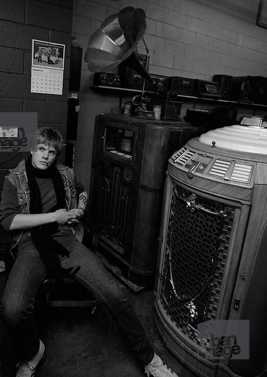 Larry Mullen of U2 visits a Juke Box store - Atlanta  USA - December 1981