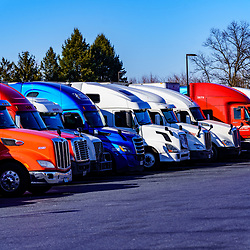 Middletown, PA / USA - February 23, 2020: A line of colorful trucks parked at a truck stop near Middletown.