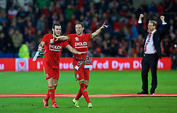 CARDIFF, WALES - Tuesday, October 13, 2015: Wales' Gareth Bale and Chris Gunter celebrate qualifying for the finals after the 2-0 victory over Andorra during the UEFA Euro 2016 qualifying Group B match at the Cardiff City Stadium. Mark Evans. (Pic by Barry Coombs/Propaganda)