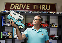 Phil Fiori holds a truck from his model car collection in his office in La Crescenta, CA.  November 4, 2015. His business is renting vehicles to commercial and film shoots. <br /> Photo by David Sprague