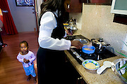 Moyahabo is preparing the breakfast to her younger doughter Tlhase (3 years old)