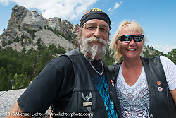 Canadian riders Marilyn Prior and Andy Robillard of Victoria, BC at Mt Rushmore National Monument during the 75th Annual Sturgis Black Hills Motorcycle Rally.  SD, USA.  August 8, 2015.  Photography ©2015 Michael Lichter.