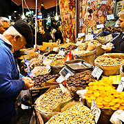 Customers buy grains and dried fruits at a store next to the Spice Bazaar (also known as the Egyption Bazaar) in Istanbul, Turkey.