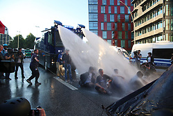 July 6, 2017 - Hamburg, Germany - Police uses water cannons on sitting protesters during demonstrations at the G20 Summit. (Credit Image: © Alexander Pohl/Pacific Press via ZUMA Wire)