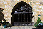 Gates at entrance of 12th Century Torre Abacial tower at Laguardia in Rioja-Alavesa area, Spain