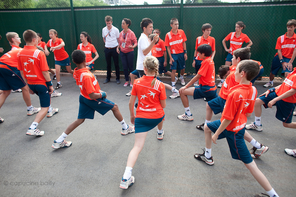 Roland Garros. Paris, France. June 1st 2012.A day with the ball boys..Warm up time with team coach