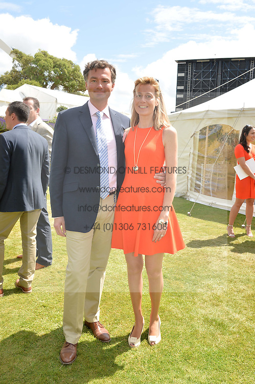 LAURENT FENIOU Managing Director of Cartier Ltd and his wife CARINE FENIOU at the Cartier hosted Style et Lux at The Goodwood Festival of Speed at Goodwood House, West Sussex on 29th June 2014.