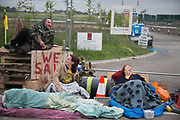 12 local activists locked themselves in specially made arm tubes to block the entrance to Quadrillas drill site in New Preston Road, July 03 2017, Lancashire, United Kingdom. Louise Robinson and Alana McCullough. The 13 activists included 3 councillors; Julie Brickles, Miranda Cox and Gina Dowding and Nick Danby, Martin Porter, Jeanette Porter,  Michelle Martin, Louise Robinson,<br /> Alana McCullough, Nick Sheldrick, Cath Robinson, Barbara Cookson, Dan Huxley-Blyth. The blockade is a repsonse to the emmidiate drilling for shale gas, fracking, by the fracking company Quadrilla. Lancashire voted against permitting fracking but was over ruled by the conservative central Government. All the activists have been active in the struggle against fracking for years but this is their first direct action of peacefull protesting. Fracking is a highly contested way of extracting gas, it is risky to extract and damaging to the environment and is banned in parts of Europe . Lancashire has in the past experienced earth quakes blamed on fracking.