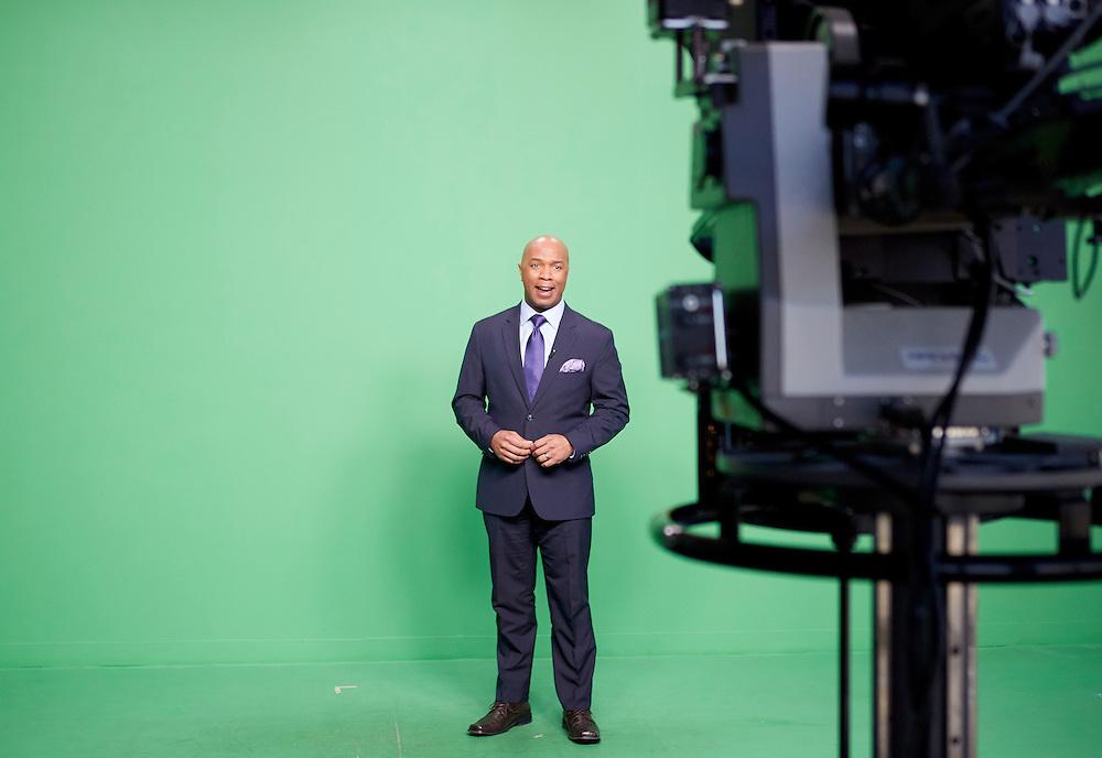 Dedham, MA 03/25/2015<br /> Fox 25 early morning anchor Daniel Miller records a public service piece against the studio's chroma key background.<br /> Alex Jones / www.alexjonesphoto.com