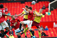 Football - 2020 / 2021 Premier League - Manchester United vs Burnley - Old Trafford<br /> <br /> James Tarkowski and Ben Mee of Burnley jump for a header with Victor Lindelof of Manchester United  at Old Trafford<br /> <br /> Credit COLORSPORT/LYNNE CAMERON