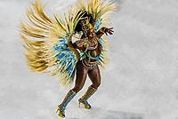 Samba dancer in the Carnaval parade of GRES Academicos de Vigario Geral samba school, Sambadrome, Rio de Janeiro, Brazil.