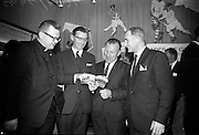 """17/05/1966<br /> 05/17/1966<br /> 17 May 1966<br /> Book reception for """"Decades of Glory: A Comprehensive History of the National Game"""" by Raymond Smith.<br /> This reception was held in the offices of W.D. & H.O. Wills to honour the well known author and journalist, Raymond Smith. His book on the history of Hurling (""""Decades of Glory"""") has just been published with the assistance of Wills of Dublin and Cork and the Central Council of the G.A.A.<br /> Picture shows (from left to right): Rev. Patrick Murray (Pallottine Father), Raymond Smith (Author), Seán Ó Síocháin (General Secretary of the G.A.A.), and Gerry Glenn."""