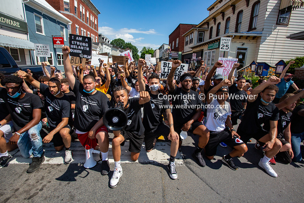 """Watsontown, PA (June 28, 2020) -- Black Lives Matter protesters kneel and chant after marching through Watsontown. The local anti-racist collective """"If Not Us, Then Who?"""" organized the protest and led the march through the borough."""