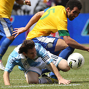 Lionel Messi, Argentina goes down from the challenge of Sandro, Brazil, during the Brazil V Argentina International Football Friendly match at MetLife Stadium, East Rutherford, New Jersey, USA. 9th June 2012. Photo Tim Clayton