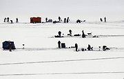 Fishermen, women and a few dogs partake in day one of the 10th Annual Ice Fishing Derby at Upper Sunshine Reservoir in Meeteetse, Wyoming on Saturday, Feb. 10, 2018. Terry and Brenda Mari of Powell, Wyoming took home the derby title with six fish measuring in at a total of 189.75 inches and left with a prize of $1,102.