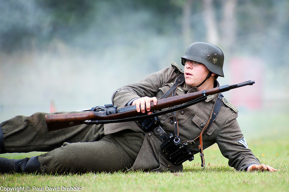 Reenactor dressed as member of the Panzer Grenadier Division Großdeutschland takes part in a Second World War Battle reenactment at Sheffield Fair at Norfolk Heritage Park Sheffield Bank Holiday Weekend.28th & 29th August 2011 Image © Paul David Drabble