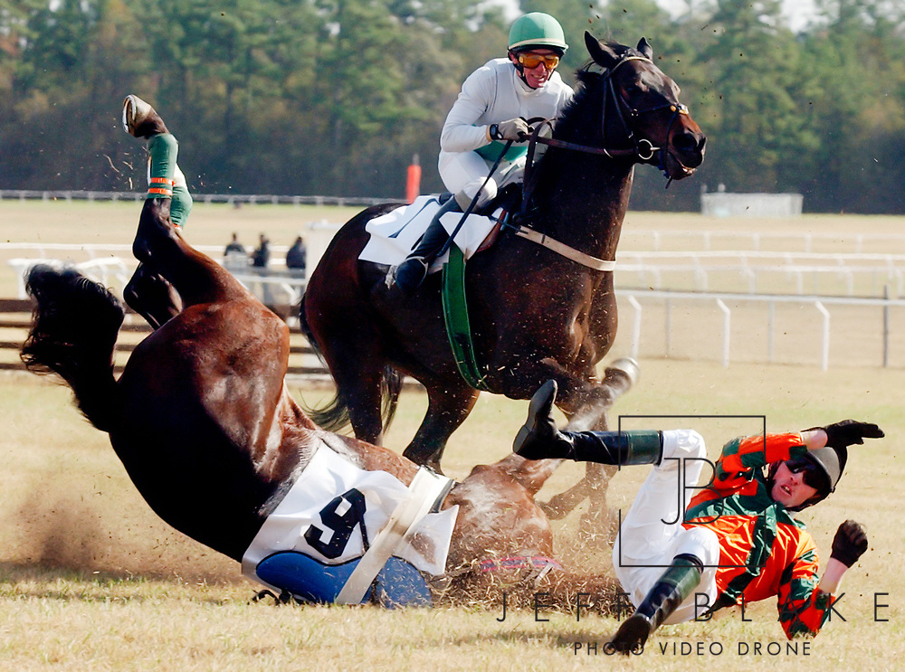 Nov. 26, 2005, Camden, SC: Jockey Paddy Young is thrown from his horse, Seeyouattheevent, after jumping a fence in the Maiden Hurdle, the first race of the day at the Colonial Cup at the Springdale Race Course. Both rider and horse escaped injury. Photo by Columbia, SC, photojournalist Jeff Blake