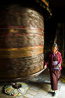 Turning Prayer Wheels at Swayambhunath Temple - Swayambhunath Temple is one of the main Buddhist temples in Kathmandu. Many Tibetan people live in the area, and make their daily procession around the temple, turning prayer wheels as they pass.