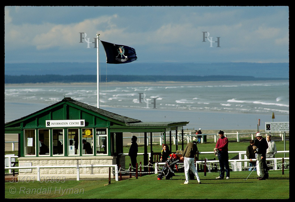 Golfer tees off at first hole of world-famous Old Course at St. Andrews Links. Scotland