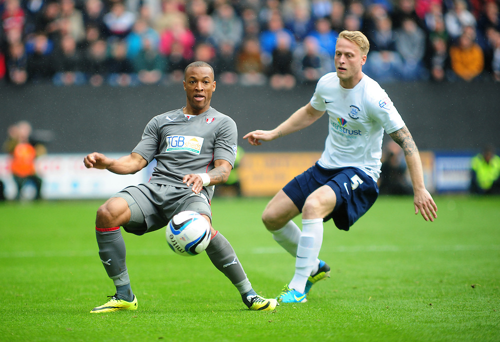 Rotherham United's Wes Thomas shields the ball from Preston North End's Tom Clarke <br /> <br /> Photographer Chris Vaughan/CameraSport<br /> <br /> Football - The Football League Sky Bet League One Play-Off First Leg - Preston North End v Rotherham United - Saturday 10th May 2014 - Deepdale - Preston<br /> <br /> © CameraSport - 43 Linden Ave. Countesthorpe. Leicester. England. LE8 5PG - Tel: +44 (0) 116 277 4147 - admin@camerasport.com - www.camerasport.com