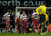 Photo: Jed Wee.<br /> Doncaster Rovers v Arsenal. Carling Cup. 21/12/2005.<br /> <br /> Doncaster players stand around as Arsenal's Robin van Persie lies injured.