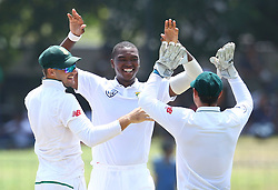 July 22, 2018 - Sri Lanka - South Africa's Lungi Ngidi (C) celebrates with teammates celebrates after he dismissed Sri Lanka's Dimuth Karunaratne during the third day of the second Test match between Sri Lanka and South Africa at the Sinhalese Sports Club (SSC) international cricket stadium in Colombo,Sri Lanka  on July 22, 2018. (Credit Image: © Pradeep Dambarage/Pacific Press via ZUMA Wire)