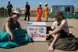 West Hyde, UK. 14th September, 2020. Environmental activists from HS2 Rebellion, including Cllr Steve Masters (l), use lock-on arm tubes to block a gate to the South Portal site for the HS2 high-speed rail link. Anti-HS2 activists blocked two gates to the same works site for the controversial £106bn rail link, one remaining closed for over six hours and another for over nineteen hours.