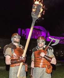 Edinburgh's Hogmanay celebrations start with the traditional torchlit procession. This year the route finishes outside the Scottish Parliament in  Holyrood where a word chosen by the young people of Scotland that makes them proud to live in the country is revealed by the thousands of torch bearers.<br /> <br /> Pictured: Jarls Men from Shetland who will lead the parade in front of the Scottish Parliament.