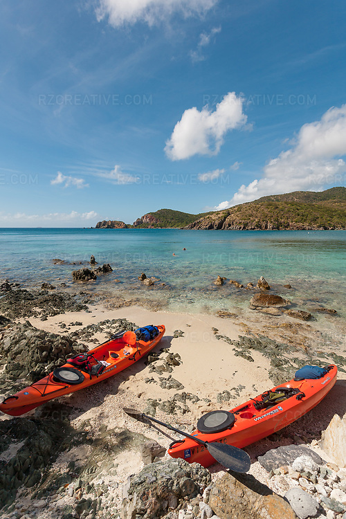 Kayaks line the beach at Yawzi Point as Ted Rutherford and Mark Anders snorkel in Little Lameshur Bay, St. John, USVI. Photo © Robert Zaleski / rzcreative.com<br /> —<br /> To license this image for editorial or commercial use, please contact Robert@rzcreative.com
