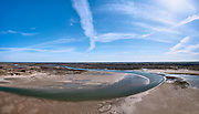 Nederland, Noord-Holland, Texel, 30-03-2021; De Slufter en Sluftervallei. In de achtergrond Polder Eijerland (Eierland). De duinvallei staat door middel van een gat in de duinen in open verbinding met de Noordzee, kreken zorgen voor de aan- en afvoer van het zeewater. Het gebied is onderdeel van hetNationaal Park Duinen van Texel en eigendom vanStaatsbosbeheer.<br /> De Slufter and Sluftervallei. The dune valley has an open connection with the North Sea, creeks provide the supply and discharge of the seawater. The area is part of the Duinen van Texel National Park.<br /> <br /> drone-opname (luchtopname, toeslag op standaard tarieven);<br /> drone recording (aerial, additional fee required);<br /> copyright foto/photo © 2021 Siebe Swart